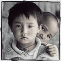 Photographs:20th Century, PHIL BORGES (American, b. 1942). Dolkar and Tashi, Dharamsala,India, 1994. Toned gelatin silver. 9 x 9 inches (22.9 x 2...
