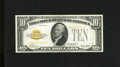 Small Size:Gold Certificates, Fr. 2400 $10 1928 Gold Certificate. About Uncirculated.. A center fold and some corner handling are noticed on this handsom...