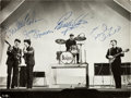 Music Memorabilia:Autographs and Signed Items, Beatles Signed Performance Photograph (Liverpool, 1963)....
