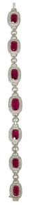Estate Jewelry:Bracelets, Ruby, Diamond, White Gold Bracelet. The bracelet is highlighted bygraduated cushion-cut rubies ranging in size from 11.70...