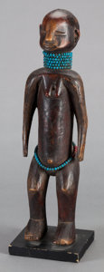 Tribal Art, (Probably) Tsonga (South Africa, Southern Africa). Female figure.Wood and glass. Height: 17-3/4 inches. ...
