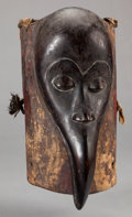 Tribal Art, Dan (Liberia or Côte d'Ivoire, Western Africa). Face mask in theform of a hornbill. Wood and fiber. Height: 12-1/2 inches. ...
