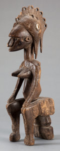 Tribal Art, Malinke/Mandinka (Mali or neighboring nation, Western Africa).Female figure. Wood and cowrie shells. Height: 18 inches. ...