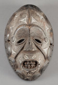 Tribal Art, Igbo (Nigeria, Western Africa). Face mask for okorosiamasquerade. Wood and pigment. Height: 8-3/4 inches. ...