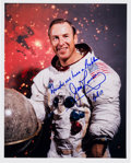 Autographs:Celebrities, James Lovell Signed White Spacesuit Color Photo....
