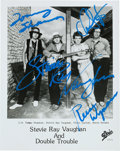 Music Memorabilia:Autographs and Signed Items, Stevie Ray Vaughan And Double Trouble Signed Promo Photo....