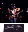 Music Memorabilia:Autographs and Signed Items, Stevie Ray Vaughan Large Signature with Color Performance Photo....