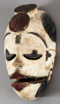 Tribal Art, Ogoni (Nigeria, Western Africa). Elu face mask. Wood andpigment. Height: 8 inches. ...
