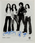 Music Memorabilia:Autographs and Signed Items, Thin Lizzy Promo Photo Signed by Lynott and Gorham....
