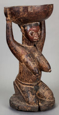 Tribal Art, Yoruba, Igbomina subgroup (Nigeria, Western Africa). Large kneelingfemale figure supporting bowl. Wood and pigment. Height:...