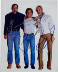 Music Memorabilia:Autographs and Signed Items, The Who Color Photo Signed by Pete, Roger, and John....