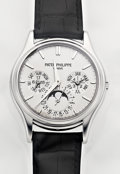 Timepieces:Wristwatch, Patek Philippe Ref. 5140G-001 Very Fine Single Sealed White GoldPerpetual Calendar With Moon Phases, Leap Year & 24 HourIndi...
