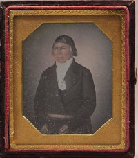 NATIVE AMERICAN WOODLANDS/GREAT LAKES INDIAN CHIEF DAGUERREOTYPE WITH A GEORGE III PEACE MEDAL, ca. 1840s-1850s.  This f...