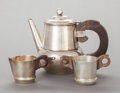 Silver & Vertu:Hollowware, AN ASSEMBLED WILLIAM SPRATLING MEXICAN SILVER AND ROSEWOOD COFFEE POT, SUGAR, AND CREAMER . William Spratling, Taxco, Mexico... (Total: 3 )