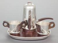 AN ASSEMBLED FOUR PIECE WILLIAM SPRATLING MEXICAN SILVER AND ROSEWOOD COFFEE SERVICE William Spratling, Taxco, Mex