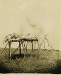 Photography:Official Photos, IMPRINTED BARRY IMAGE OF INDIAN BURIAL SITE. Large sepia image of a Sioux burial site, showing several bodies on an elevated... (Total: 1 Item)