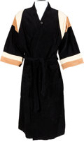 Music Memorabilia:Costumes, Elvis Presley Owned/Worn Black Velour Bathrobe (1970s)....