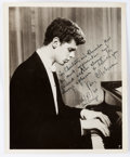 "Autographs:Artists, Pianist Van Cliburn Inscribed Photograph Signed. Measuring 8.25"" x10"", the pianist is seen in his youth at the piano. He ha..."