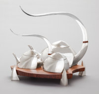 A FOUR PIECE MICHAEL AND MAUREEN BANNER SILVER AND BRAZILIAN ROSEWOOD TEA SERVICE: TALES </