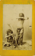 Photography:Cabinet Photos, CABINET IMAGE OF TWO CROW BOYS FROM THE THOMAS NAST COLLECTION.Sobering studio image of two young Crow boys aiming their bo...(Total: 1 Item)