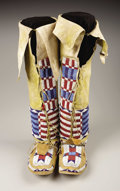 American Indian Art:Beadwork, A PAIR OF CHEYENNE WOMAN'S BEADED HIDE LEGGINGS AND MATCHINGMOCCASINS. c. 1885. ...
