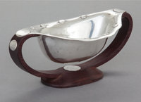 A WILLIAM SPRATLING MEXICAN SILVER AND ROSEWOOD SAUCE BOWL William Spratling, Taxco, Mexico, circa 1965-1967 Ma