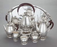 A SEVEN PIECE CODAN MEXICAN SILVER AND ROSEWOOD TEA AND COFFEE SERVICE Codan S. A., Mexico City, Mexico, circa 195