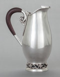 Silver & Vertu:Hollowware, A CODAN SILVER AND ROSEWOOD WATER PITCHER. Codan S. A., Mexico City, Mexico, circa 1950. Marks: CODAN, STERLING, 925, MEXI...