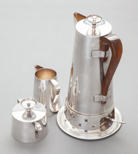A FOUR PIECE DORLYN SILVERSMITHS SILVER-PLATED AND WOOD COFFEE SERVICE, DESIGNED BY TOMMI PARZINGER Dorlyn Silvers