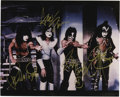 "Music Memorabilia:Autographs and Signed Items, Kiss Signed Photo. A color 8"" x 10"" band photo signed by PaulStanley, Ace Frehley, Peter Criss, and Gene Simmons in gold ma...(Total: 1 Item)"