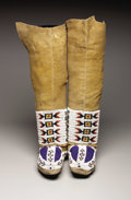 American Indian Art:Beadwork, A PAIR OF PLAINS WOMAN'S BEADED HIDE BOOT MOCCASINS. c. 1890. ... (Total: 2 Items)