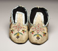 American Indian Art:Beadwork, A PAIR OF SANTEE SIOUX BEADED HIDE MOCCASINS. c. 1890. ... (Total:2 Items)