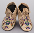 American Indian Art:Beadwork and Quillwork, A PAIR OF SANTEE SIOUX BEADED HIDE MOCCASINS. c. 1890... (Total: 2Items)