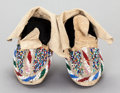 American Indian Art:Beadwork and Quillwork, A PAIR OF SIOUX CHILD'S BEADED HIDE MOCCASINS... (Total: 2 )