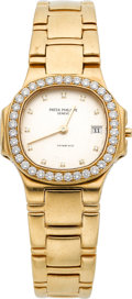 Timepieces:Wristwatch, Patek Philippe Ref. 4700/530 Lady's Gold Nautilus With Diamonds....