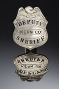 Western Expansion:Cowboy, DEPUTY SHERIFF - KERN CO., CALIFORNIA SHIELD BADGE CIRCA 1910 - Apleasing eagle-topped shield badge made of solid nickel si...(Total: 1 Item)