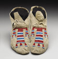 American Indian Art:Beadwork, A PAIR OF SIOUX BEADED HIDE MOCCASINS. . c. 1900 . ... (Total: 2Items)