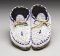 American Indian Art:Beadwork, A PAIR OF SIOUX CHILD'S BEADED HIDE MOCCASINS. c. 1900. ... (Total:2 Items)