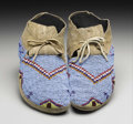 American Indian Art:Beadwork, A PAIR OF SIOUX BEADED HIDE MOCCASINS. . c. 1890. ... (Total: 2Items)