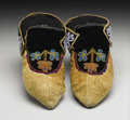 American Indian Art:Beadwork, A PAIR OF CHIPPEWA BEADED HIDE MOCCASINS. . c. 1900... (Total: 2Items)