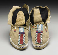 A PAIR OF CHEYENNE BEADED HIDE MOCCASINS c. 1890