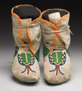 American Indian Art:Beadwork, A PAIR OF BLACKFEET BEADED HIDE MOCCASINS. c. 1900. ... (Total: 2Items)