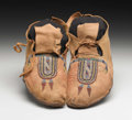 American Indian Art:Beadwork, A PAIR OF CROW BEADED HIDE MOCCASINS. . c. 1880. ...