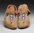 American Indian Art:Beadwork, A PAIR OF CROW BEADED HIDE MOCCASINS. . c. 1885. ... (Total: 2Items)