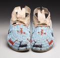 American Indian Art:Beadwork, A PAIR OF CHEYENNE PICTORIAL BEADED HIDE MOCCASINS. . c. 1900. ...(Total: 2 Items)