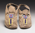 American Indian Art:Beadwork, A PAIR OF SIOUX BEADED HIDE MOCCASINS. c. 1890. ...