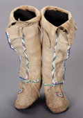 American Indian Art:Beadwork and Quillwork, A PAIR OF KIOWA GIRL'S BEADED HIDE HIGHTOP MOCCASINS. c. 1910...