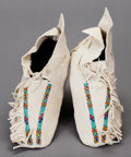 American Indian Art:Beadwork and Quillwork, A PAIR OF SOUTHERN CHEYENNE BEADED HIDE MOCCASINS...