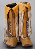 American Indian Art:Beadwork and Quillwork, A PAIR OF COMANCHE BEADED HIDE BOOT MOCCASINS...