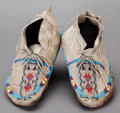 American Indian Art:Beadwork and Quillwork, A PAIR OF SOUTHERN PLAINS BEADED HIDE MOCCASINS...